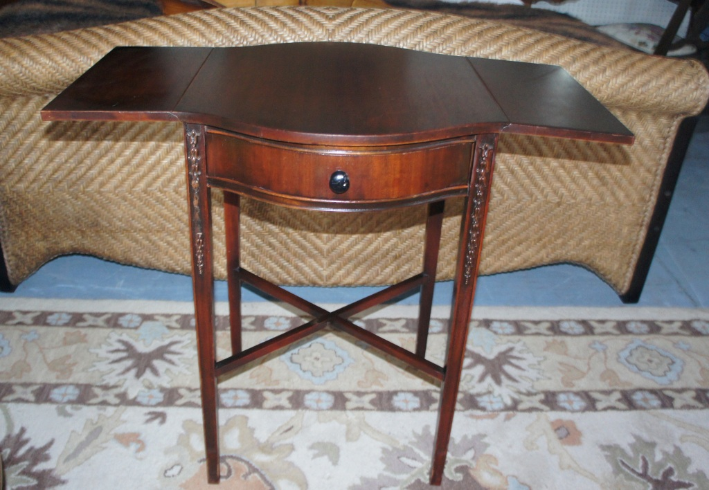 "Drop leaf ""butterfly"" side table with single drawer."