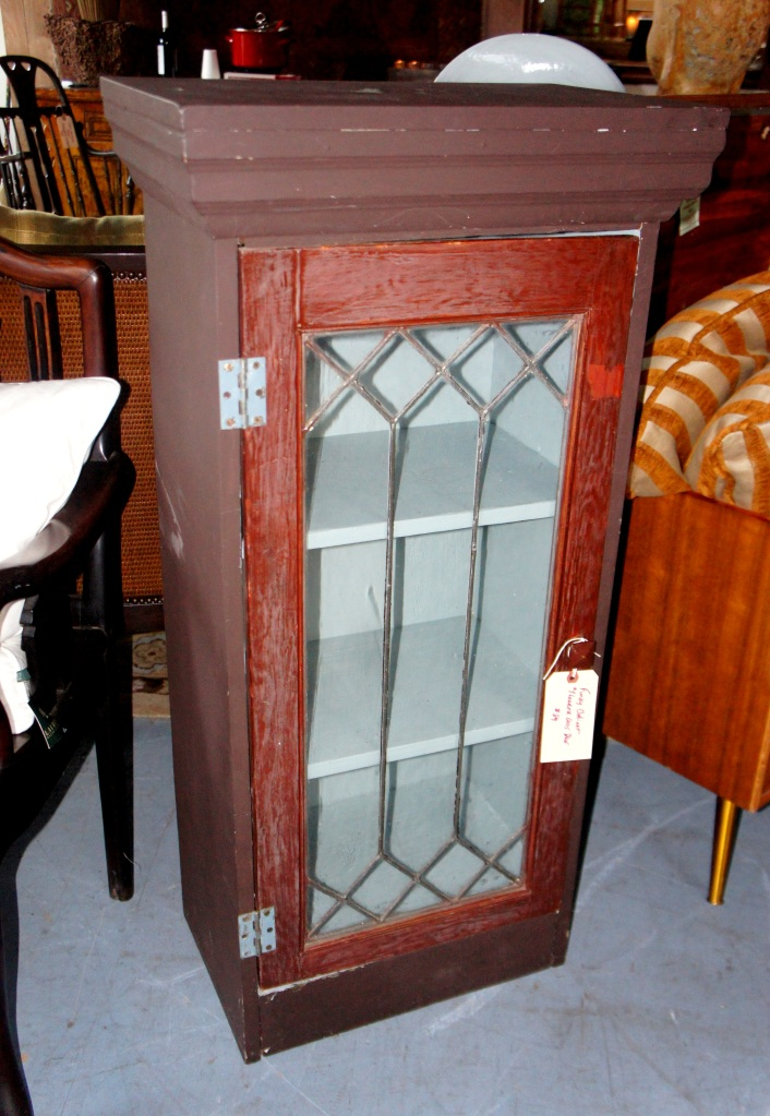 Cabinet with leaded glass door and 3 shelves. Fun for just about any room.