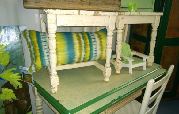 green farm table and pillow