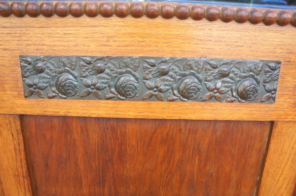Beautiful beading and hammered metal rosettes are too sweet for words.