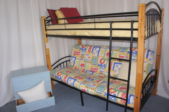 Wrought Iron and Solid Pine Bunk Beds. Bottom is full size bed or futon sofa, top is twin. Can be used stacked or as stand alone sofa and twin bed.