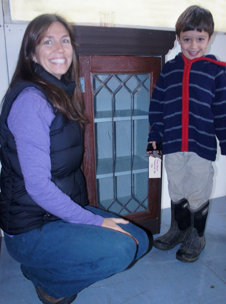 The smile and eyes say it all! Jaime and her son were tickled to find this leaded glass cabinet for their entry.