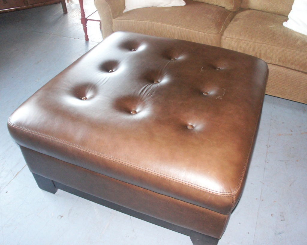 Large square brown ottoman with storage.