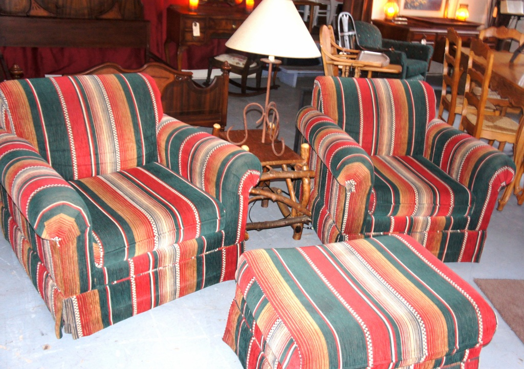 Pair of handsomely upholstered lodge chairs with ottoman. Very comfortable.