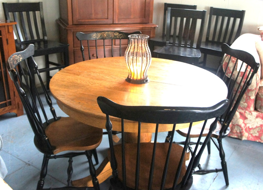 Antique Round Oak Table on casters, includes 2 leaves. (SOLD)                                                                                                L. Hitchcock Classic  New London Side Chairs., Set of four.<br />Four Pottery Barn black finish bar stools.(SOLD)