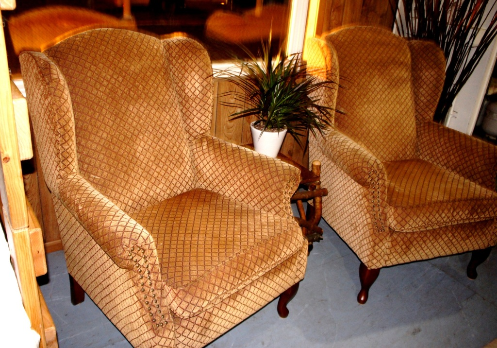 Pair of handsome wing back chairs in rich upholstery with nail heads.
