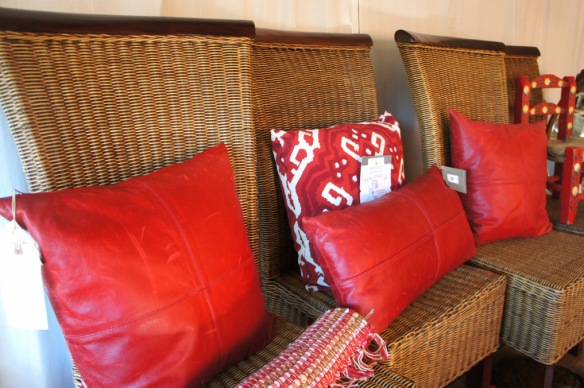 woven-chairs-and-red-pillows
